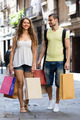 happy young loving pair with shopping bags at city - PhotoDune Item for Sale