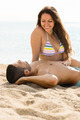 Loving pair laying on sand beach - PhotoDune Item for Sale