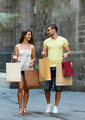 smiling loving couple with shopping bags at city - PhotoDune Item for Sale