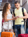 Couple with GPS navigator and baggage - PhotoDune Item for Sale