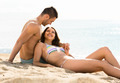 Loving couple relaxing on sand beach - PhotoDune Item for Sale