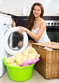 Nice woman washing clothes in washer - PhotoDune Item for Sale