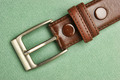 leather belt with a buckle on a green background - PhotoDune Item for Sale