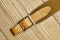 leather strap with a buckle on a wooden board - PhotoDune Item for Sale