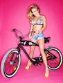 Seductive young blond on a bicycle - PhotoDune Item for Sale