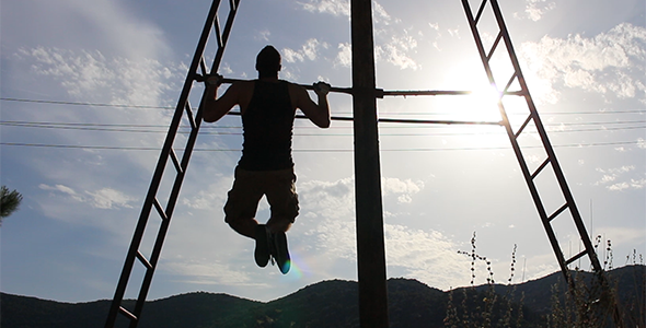 Strong Man doing Pull Ups under the Sun