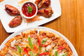 Delicious fresh pizza served Chicken Wings on wood background - PhotoDune Item for Sale