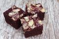 Almond brownie on old wood - PhotoDune Item for Sale