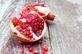 Juicy pomegranates on wood - PhotoDune Item for Sale