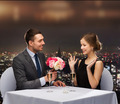 smiling man giving flower bouquet to woman - PhotoDune Item for Sale