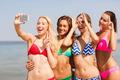 group of smiling women making selfie on beach - PhotoDune Item for Sale