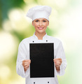 smiling female chef with black blank paper - PhotoDune Item for Sale