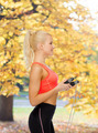 smiling sporty woman with skipping rope - PhotoDune Item for Sale