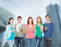 smiling students with smartphones - PhotoDune Item for Sale