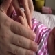 Mom Gives Oil on Baby s Hand 01 - VideoHive Item for Sale