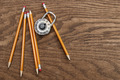 Pencils and lock on wood surface - PhotoDune Item for Sale