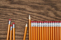 A row of red pencils on wood surface - PhotoDune Item for Sale