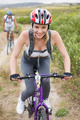 Fit couple cycling on mountain trail on a sunny day