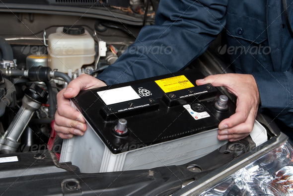 PhotoDune Auto mechanic replacing car battery 901383
