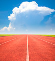 red running track over blue sky and clouds background - PhotoDune Item for Sale