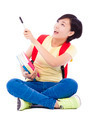 beautiful student asian girl holding pen and sitting on floor over white background - PhotoDune Item for Sale
