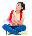 young student girl sitting on floor with book over white background - PhotoDune Item for Sale