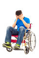 upset handicapped man sitting on a wheelchair over white background - PhotoDune Item for Sale