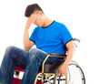 depressed and handicapped man sitting on a wheelchair over white background - PhotoDune Item for Sale