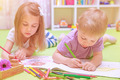 Happy baby boy & girl enjoying homework - PhotoDune Item for Sale