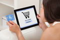 Woman With Credit Card Shopping Online On Digital Tablet - PhotoDune Item for Sale