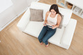 Young Woman Using Digital Tablet On Sofa - PhotoDune Item for Sale