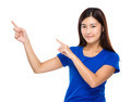 Asian woman with two finger point up - PhotoDune Item for Sale