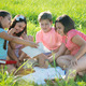 Group of children playing on grass - PhotoDune Item for Sale