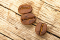 Roasted coffee beans on old wooden table - PhotoDune Item for Sale