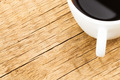 White ceramic coffee cup on old wooden table - view from top - PhotoDune Item for Sale