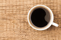 Black coffee in white ceramic cup on wooden table - PhotoDune Item for Sale