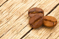 Roasted coffee beans on old wooden table - view from top - PhotoDune Item for Sale