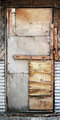 old shaky wooden patio door patched with plywood - PhotoDune Item for Sale