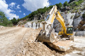 excavator at a construction site - PhotoDune Item for Sale
