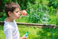Child makes bubbles - PhotoDune Item for Sale