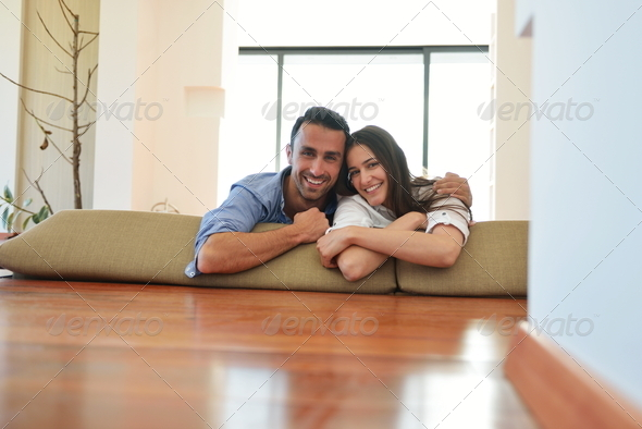 relaxed young couple at home - Stock Photo - Images