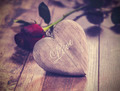 Vintage picture of heart on a wooden background with red rose. - PhotoDune Item for Sale