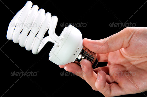 energy saving light bulb in hand - Stock Photo - Images