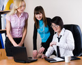 Three attractive business ladies work with laptop in office - PhotoDune Item for Sale