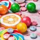 multicolored sweets and chewing gum on a wooden table - PhotoDune Item for Sale