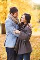 smiling couple hugging in autumn park - PhotoDune Item for Sale