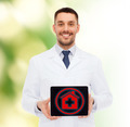 smiling male doctor with tablet pc - PhotoDune Item for Sale