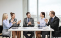 business team with laptop clapping hands - PhotoDune Item for Sale