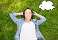 smiling young girl in headphones lying on grass - PhotoDune Item for Sale