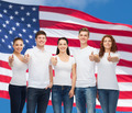 smiling teenagers in t-shirts showing thumbs up - PhotoDune Item for Sale